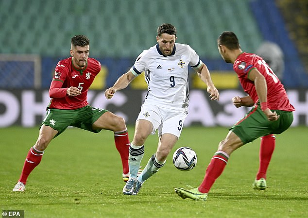 Washington holds the ball up - his goal put Northern Ireland ahead but they couldn't hold on