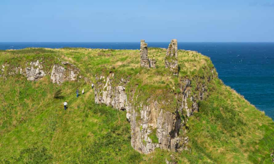 Walkers climb up to Dunseverick Castle.