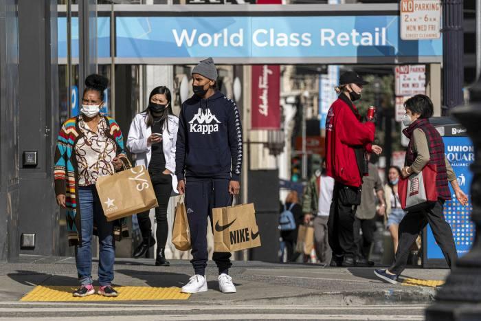 Pedestrians carry shopping bags in San Francisco