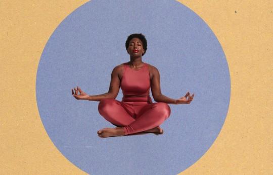 woman meditating sitting crosslegged