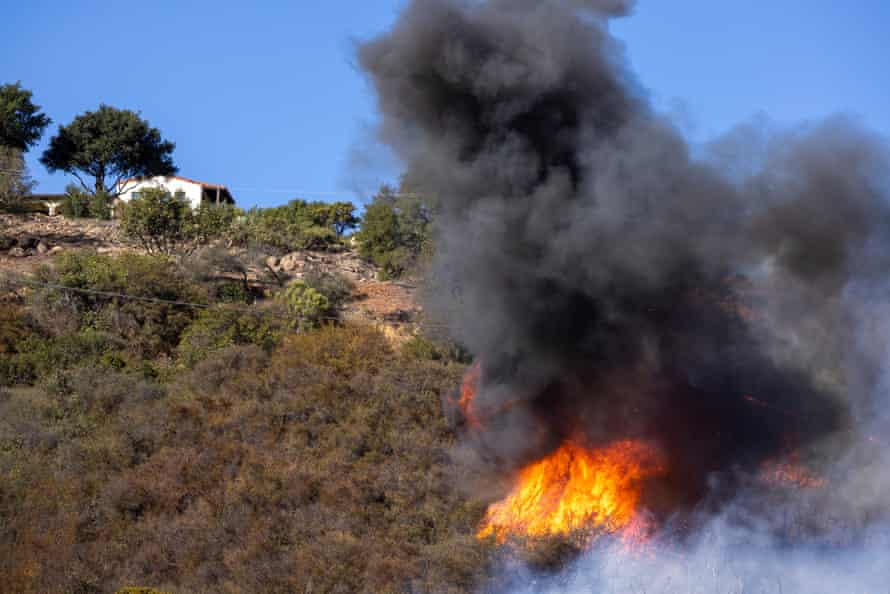 Flames from the Alisal fire burn close to a home near Goleta, California.
