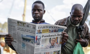 People read the morning newspapers reporting a statement issued by President Uhuru Kenyatta following reports that he is among more than 330 current and former politicians identified as beneficiaries of secret financial accounts, in the low-income Kibera neighborhood of Nairobi, Kenya.