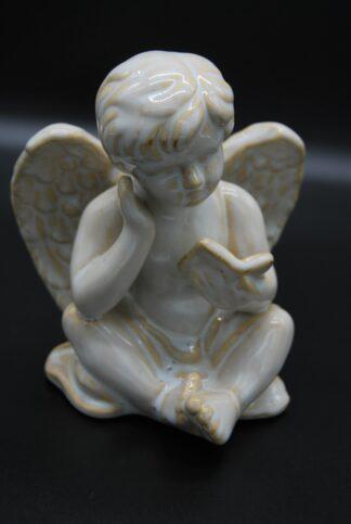 zittende engel met boek 1