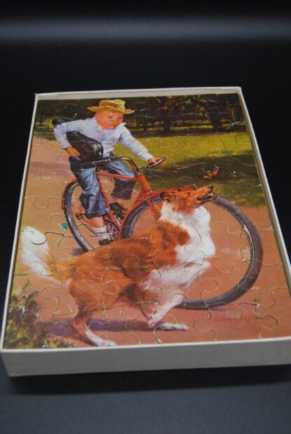 Hond en fietsende jongen puzzel Jumbo, jaren 60