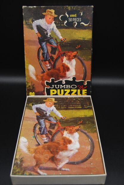 Vintage legpuzzel Jumbo Jongen op fiets met schotse collie