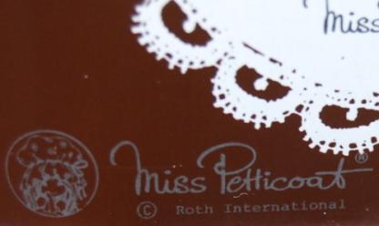 Miss Petticoat bruin blik vintage