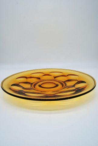 Glazen schaal met relief in glas amberkleur
