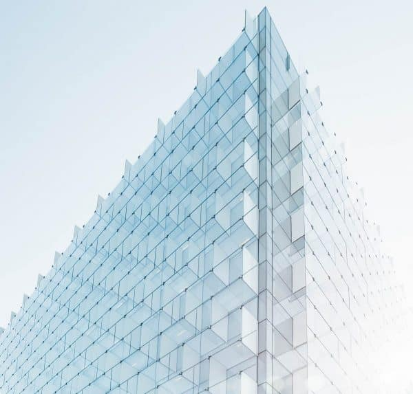 Modern glass building isolated on a light blue background // White Label Consultancy Homepage // Privacy and Data Protection Consulting