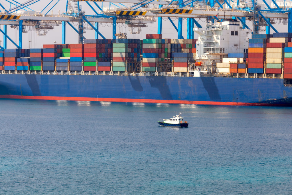 Huge container ship in the cargo port of the island of Malta. Marsaxlokk.