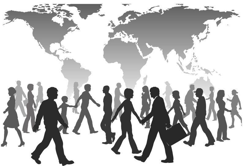 silhouette people walking infront of world map