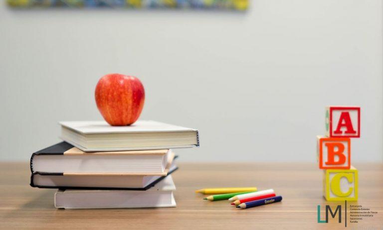 Teacher table books crayons blocks & LM Abogados logo