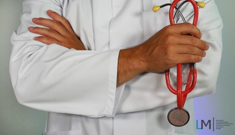 Doctor arms holding red stethoscope & LM Abogados logo