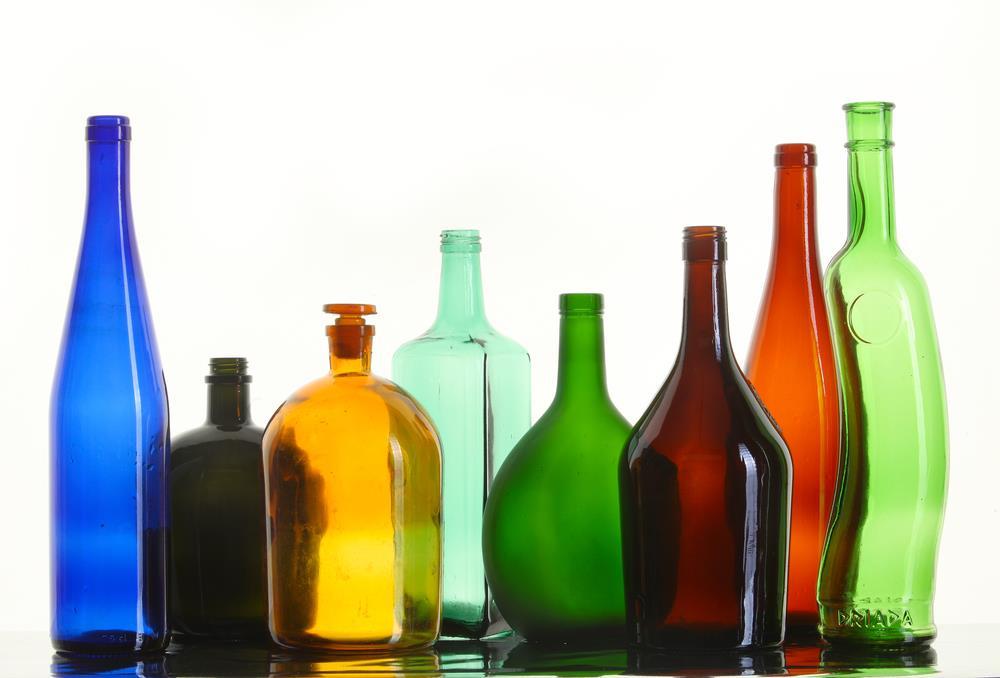 etichette per bottiglie e contenitori cilindrici