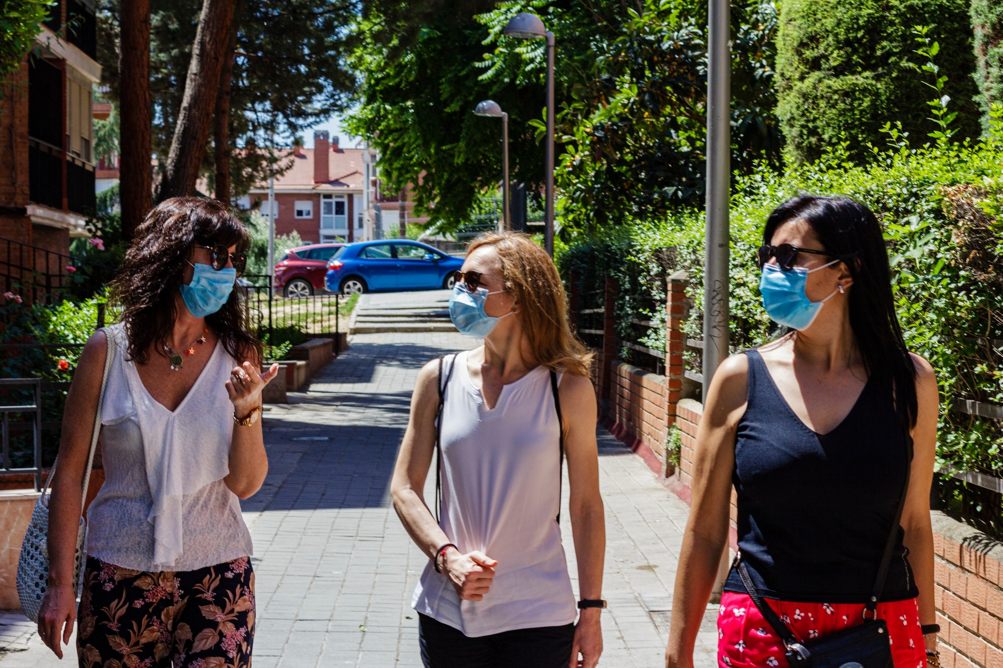 Three woman going for a walk wearing face mask in a new normal