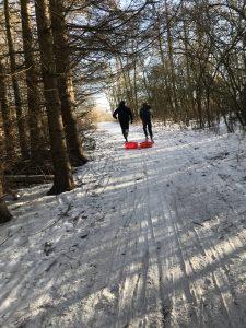 boys running in snow