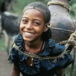 young-amhara-transporting-water