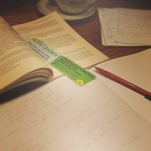 Paper, pencil, bookmark and a text book