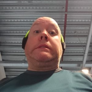 Guy pulling a stupid face at the gym