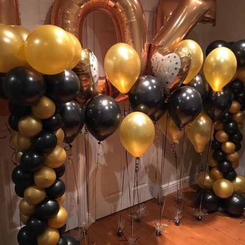 black gold and silver balloons numbers and columns