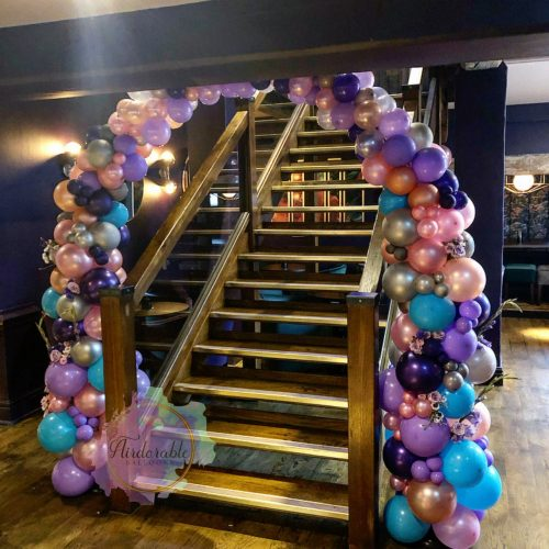balloon arch pink turquoise purple and silver