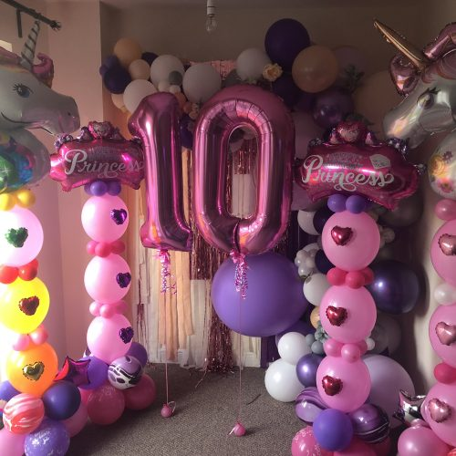 pink number 10 balloons and columns