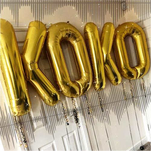 gold helium balloon letters spelling koko