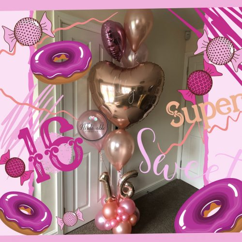 gold and pink balloon column with heart