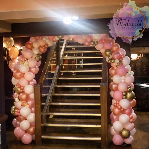pink white and gold balloon arch