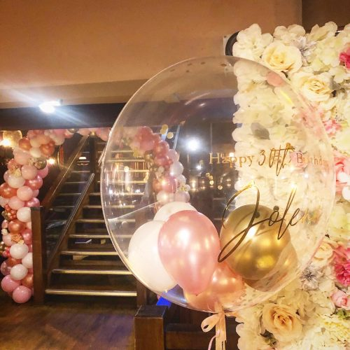clear bubble balloon personalised vinyl writing and pink and ivory flower wall