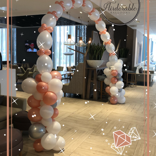 white and coral link balloon arch