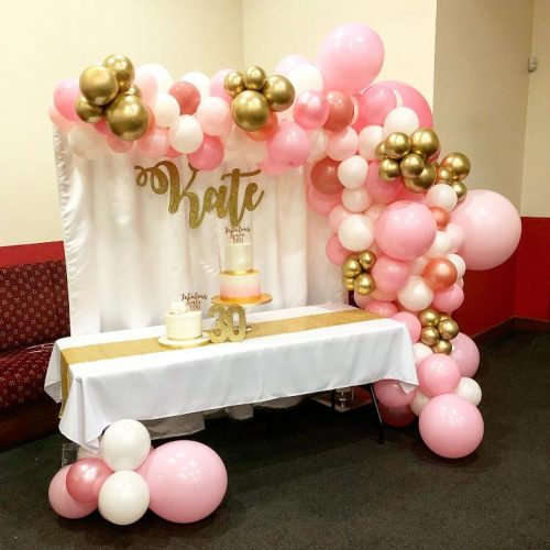 pink white and gold balloon garland backdrop curtain and table decor