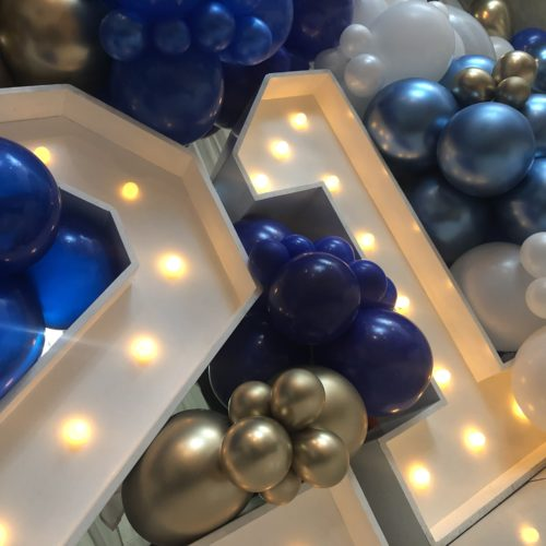 blue white and gold balloons on number 21