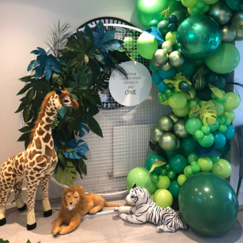 jungle theme balloon foliage and backdrop with green balloons