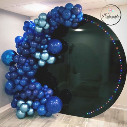 Blue balloon garland on back led backdrop