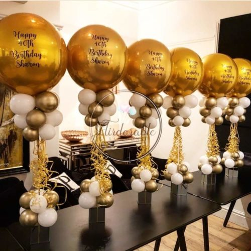 white and gold balloon centre pieces