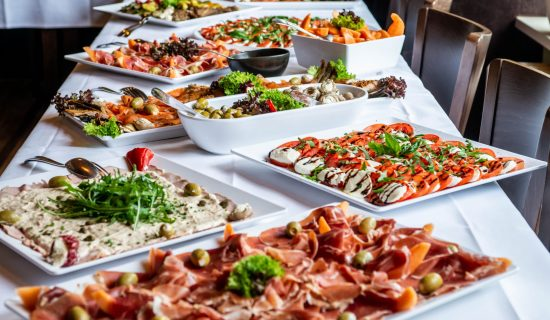 Party Brunch big Buffet table setting with Food Meat Vegetables.