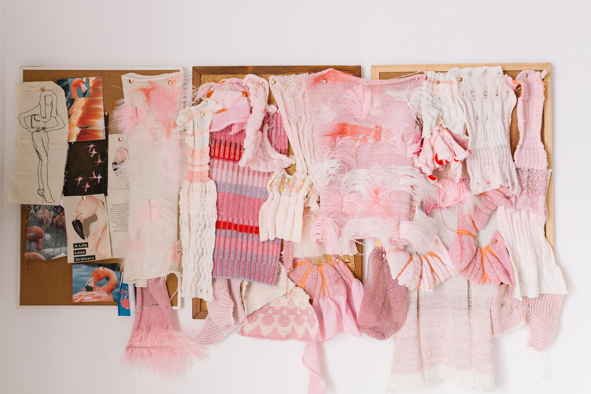 machine knit fabric samples displayed on a cork board