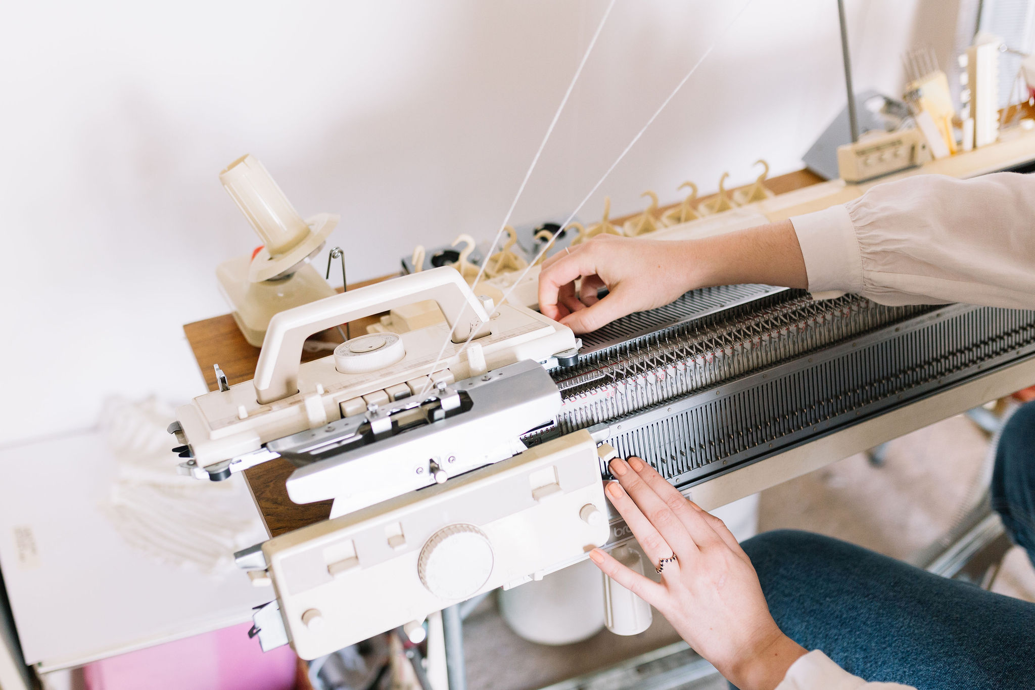 brother knitting machine with ribber being operated by Amber Hards