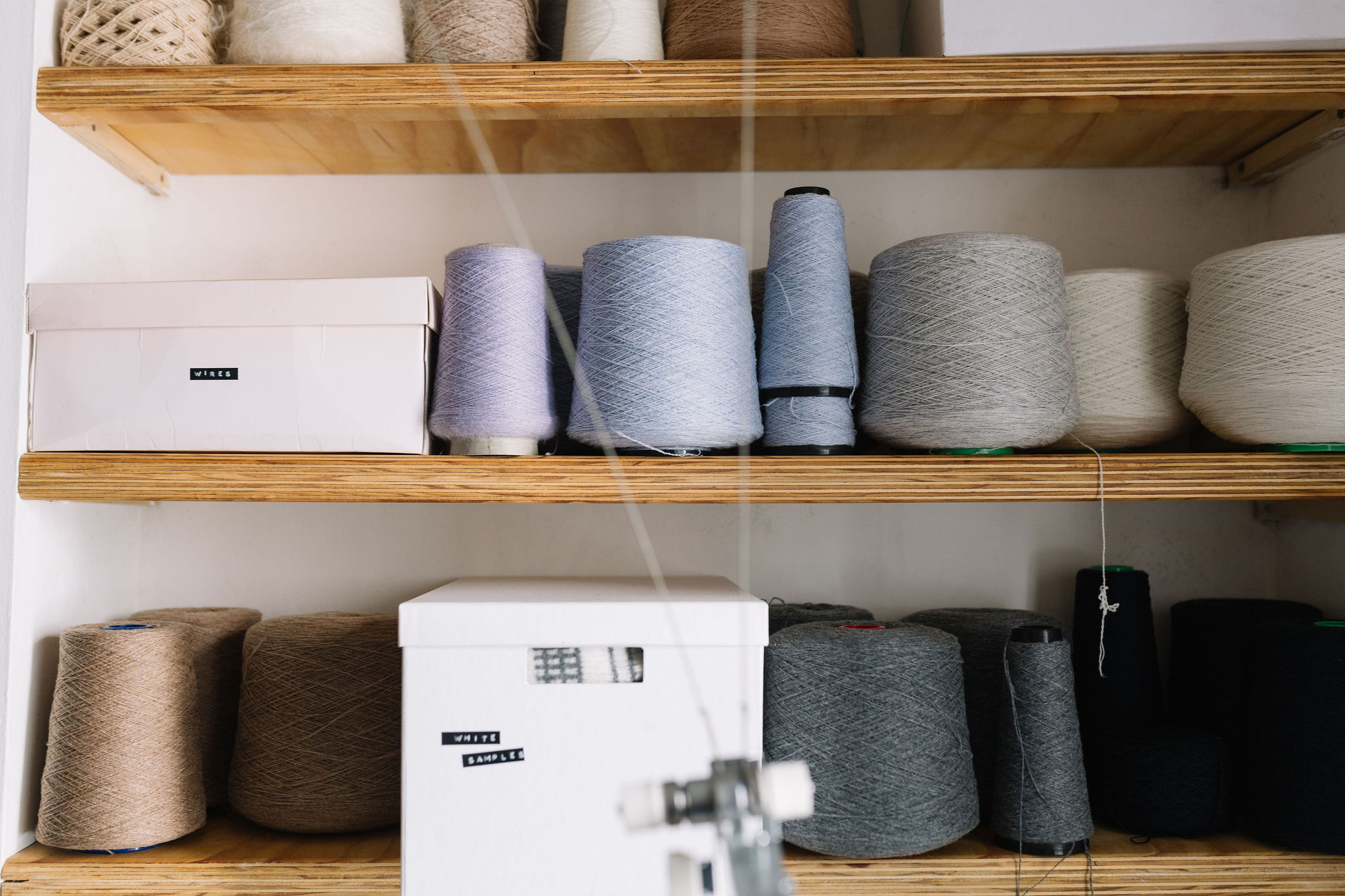 cones of wools on a shelf
