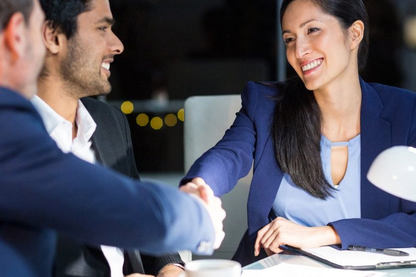 Businessman shaking hands with a colleague in the office-1