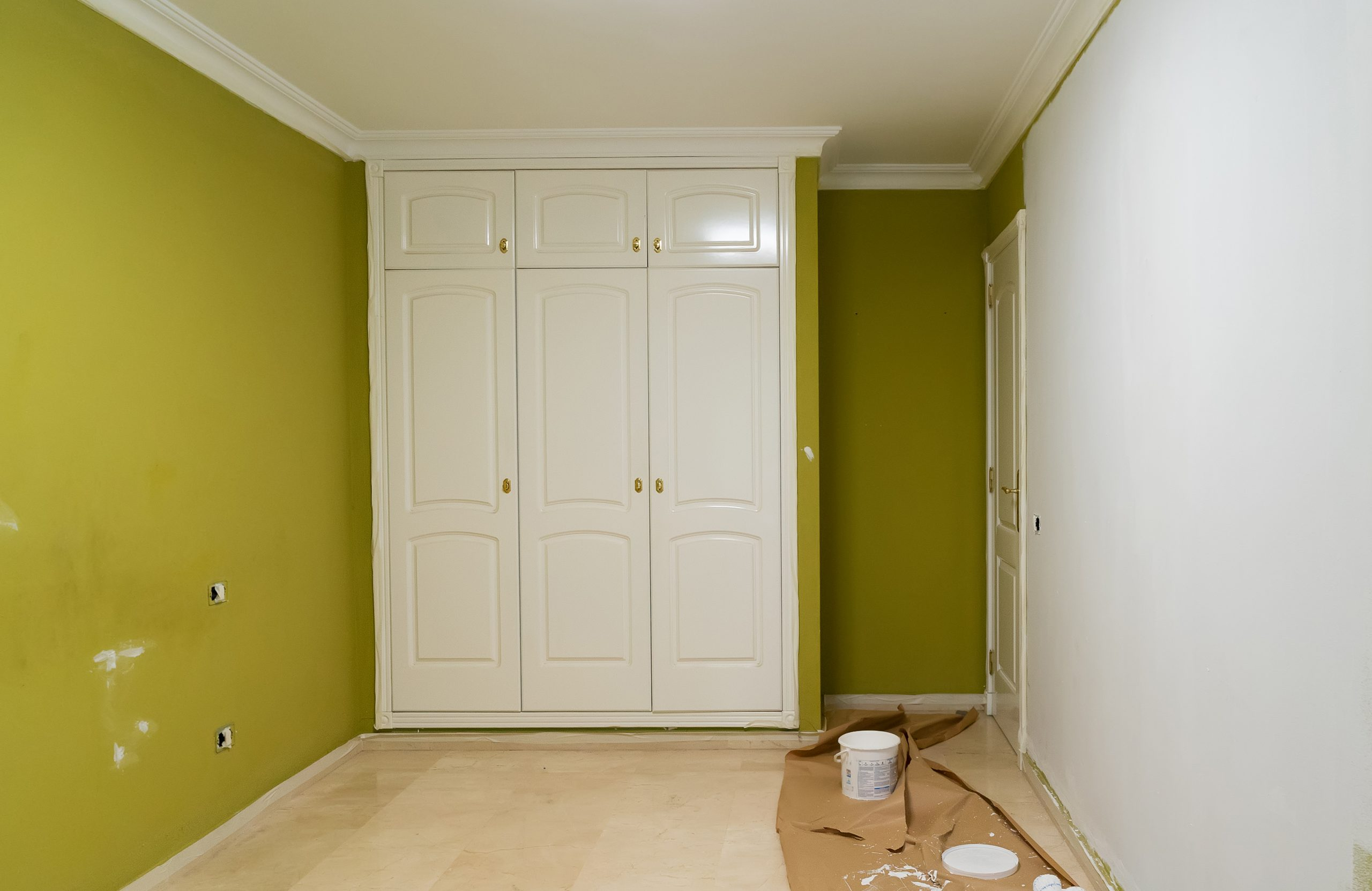 home renovation concept - old flat during restoration or refurbishment with newly painted white walls