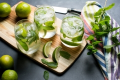 Making mojitos with mint and lime