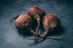 Red beets on blue-gray background