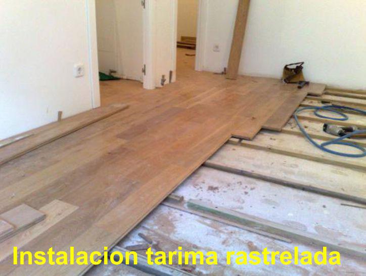 Arcolinea: obras y reformas. Instalación de tarima maciza sobre rastreles de pino recibidos.