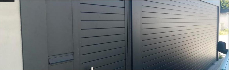 Puerta o cierres metálicos enrollables con puerta abatible peatonal