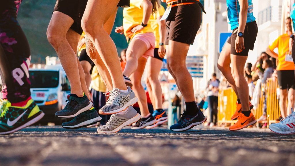 people-wearing-running-shoes-2526878