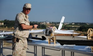 Russian general Igor Konachenkov presents what he says are intercepted handcrafted drones intercepted near the Khmeimim base in Syria.