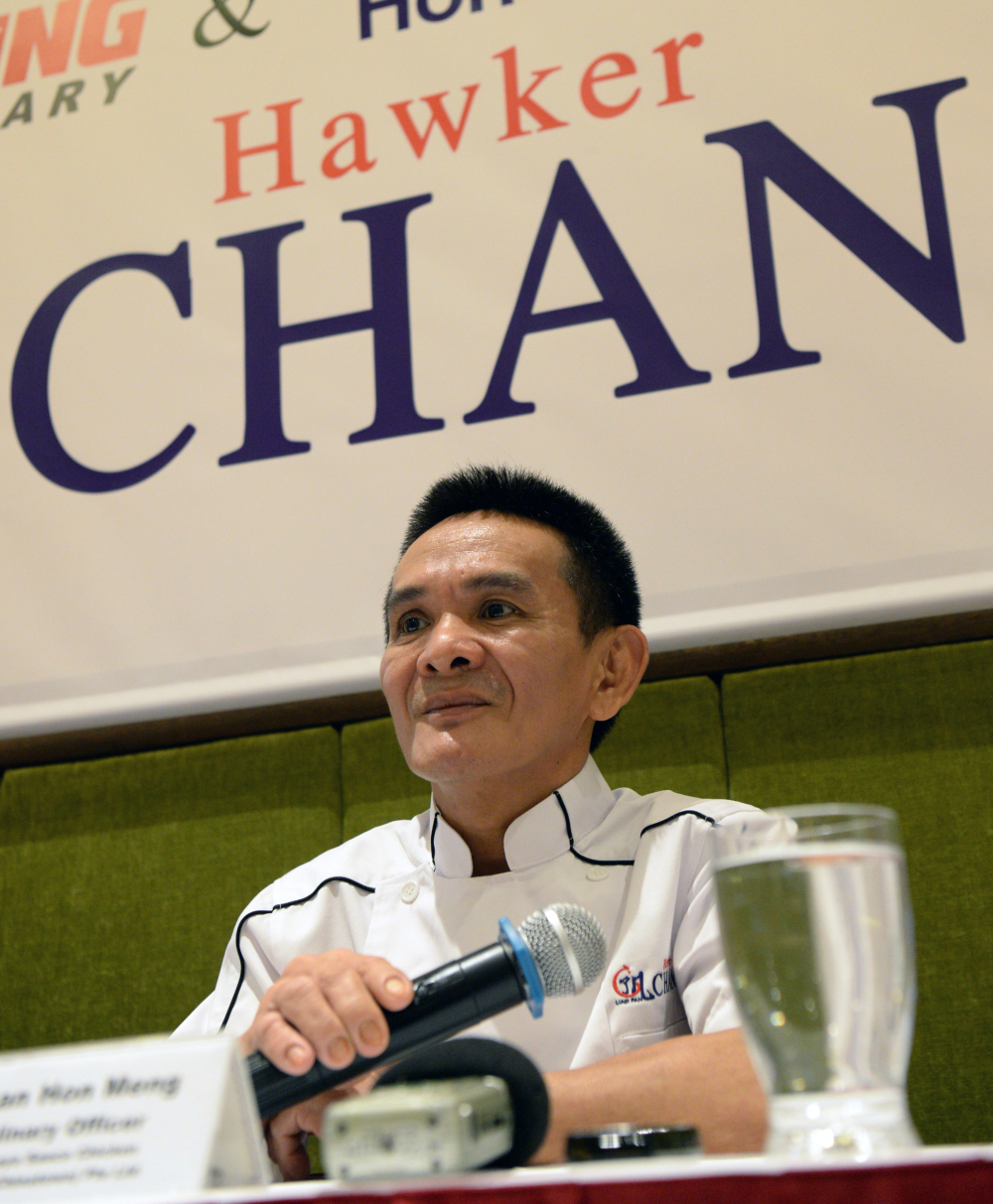 Chef Chan Hon Meng, nicknamed 'Hawker Chan', runs the world's least expensive Michelin-starred restaurant in Singapore. — AFP pic
