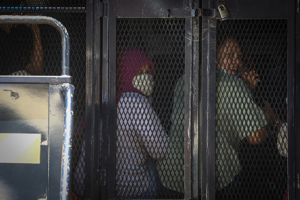 Illegal immigrants are detained by the Immigration Department following raids carried out at Selayang Baru in Kuala Lumpur May 14, 2020. — Picture by Yusof Mat Isa