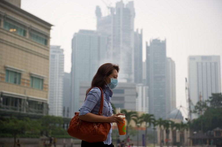 He said Malaysian Public Health Physicians' Association president Datuk Dr Zainal Ariffin Omar says people should continue to mask up whether or not haze occurs this year as Covid-19 spreads through droplets and is not an airborne virus. — AFP pic